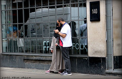 `2058 (roll the dice) Tags: london westminster w1 gay redlight soho westend londonist streetphotography muslim veiled burka niqab burqa religion sad mad fun funny surreal people natural uk art classic sign windiws eyes pretty sexy couple portrait strangers candid peep canon tourism tourists sex fashion dark shops shopping flow mobile lost phone reflections whitevan shadows