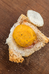 Breakfast quiche with bread, lardons and an egg. (annick vanderschelden) Tags: muffin tray muffintray baking bread lardons pork breakfast oven heat temperature quiche food morning egg ready served wood brown board blackpepper belgium