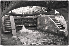 Lock Under the Bridge (tatzlum.photo) Tags: blackwhite blackandwhite grandunioncanal leicamp240 steps bridge sepia lock 50mm monochrome canal