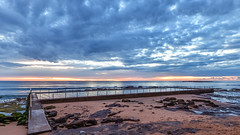 Cloudy Sunrise Seascape and Sea Pool (Merrillie) Tags: daybreak sand landscape nature water newsouthwales rocks nsw beach scenery seapool clouds newport earlymornings waterscape sea australia dawn seascape