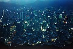 .city lights. (Camila Guerreiro) Tags: film night lights pentaxmesuper cinestill camilaguerreiro seoul southkorea analog cinestill800tungsten grain