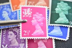 "The Queen. The original ""Selfie"". (rawdonfox) Tags: macromonday macromondays queen queens stamp postage lsd predecimal twoeyed portrait selfie rawdonfox nikond5200 nikon tweezers"