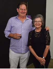 Armando Droulers with Liana Perez from Art Circuits at Uaio Antor opening in Wynwood