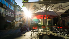 It's summer (frankdorgathen) Tags: sunshade backlight color colorful outdoor nordrheinwestfalen ruhrgebiet essen restaurant street urban town city summer daylight light sun sunset
