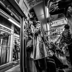 I'm on my way (Mario Rasso) Tags: mariorasso train subway woman phone japan japon tokyo tokio people nikon d800