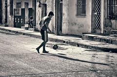 Street Soccer (Artypixall) Tags: cuba camaguey teenagerboy streetsoccer ball shadows blackandwhite urbanscene