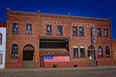 HOTEL PFISTER (akahawkeyefan) Tags: hotel empty closed rushville nebraska davemeyer flags buntings us