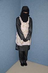 Sklave Waitress (Warm Clothes Fetish) Tags: niqab hijab chador burka girl anorak coat rainwear sweat boots torture slave warm maid waitress apron
