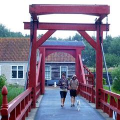 Bourtange in the rain (gerben more) Tags: bourtange rain people bridge house netherlands nederland men youngman dog