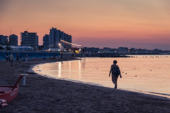 At sunset, the beach gets empty / Le soleil se couche, la plage se vide... / (Gilderic Photography) Tags: italie sunset cattolica beach plage woman sea adriatic seascape canon 500d gilderic vacation summer