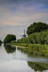 8A0A4085 (ct_purley) Tags: belgium bruges damme real canal windmill trees