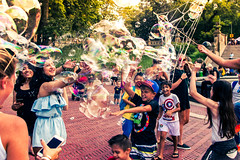I wish I was a kid again (The Endz7) Tags: newyork nikon d3200 centralpark nyc people crowd bubbles street 35mm newyorkcity colorful red orange strangers