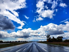 Highway, westbound, Ontario (duaneschermerhorn) Tags: highway road horizon clouds sky blue white trees