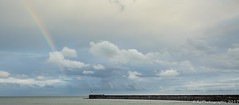 Newb-1 (RJ Photographic (700,000 views Thank You)) Tags: brightonseascape newhaven clouds ferry lighthouse ocean signs water rainbow