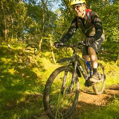 happy chap on a bike (grahamrobb888) Tags: nikon nikond800 sigma20mmf18 sigma scotland summer sunny birnamwood birnam bicycle bicycles mountainbike bike bikers perthshire fun recreation holiday vacation woods woodland grass green