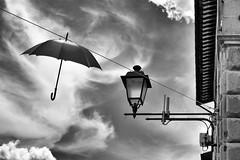 Where is my umbrella? (Ale Giov) Tags: umbrella sky monocrome countryside