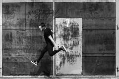 Self Jumping (hmgsilva) Tags: jump bw black grey white door seven tag gra graphiti hard light soft man jumping