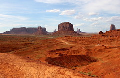 Monumental point of view (mpalmer934) Tags: monument valley navajo tribal park arizona utah desert landscape dirt road buttes mesas red blue sky clouds awe tranquility serene calme wild west western scenery scene rock stone formations sand view
