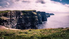 Cliffs of Moher panorama - Clare, Ireland - Landscape photography (Giuseppe Milo (www.pixael.com)) Tags: grass clare natural landscape ireland cliffs landmark cliffsofmoher outdoor panorama rocks travel tower water seascape moher popular nature sea countyclare ie onsale