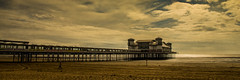 Walking by the Pier (Brian Travelling) Tags: grand pier westonsupermare beach england somerset pentax