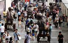 Rebirth (Andy WXx2009) Tags: people outdoors hongkong streetphotography statue art artistic crowd men street women china candid asia city urban tourism display walking