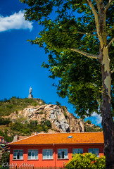 Statue (Khalid H Abbasi) Tags: plovdiv bulgaria sonydscrx100m3 hill sky alyoshamonument blue tree statue sculpture vasilaprilovboulevard