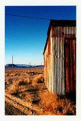 Corrugated (tobysx70) Tags: nikon f2 photomic kodak ektachrome lumiere 100 professional 35mm 135 color slide film 5046 lpp crossprocessed xpro corrugated gold point nevada nv rust rusty oxidized abandoned cabin shack building silver mine mining ghost town blue sky landscape utility pole mountains toby hancock photography