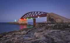 Evening at Breakwater Bridge (yasjooni) Tags: nikon nikond7200 d7200 longexposure night malta lowlight light sea seascape bridge rocks reflections reflection water lights lighthouse