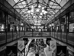 Brisbane Arcade (michelle-robinson.com) Tags: editedonipad brisbane diminishingperspective xt10 shoppingarcade documentary queensland society bw australia lamps everyday editedonipadair life everydayaustralia photography shops dailylife blackandwhite vanishingpoint ceiling blackandwhitephotography interiorarchitecture angles flickrelite 4tografie culture adelaideartist snapseed arcade interior michellerobinson architecture building heritage monochrome adelaidephotographer balcony fujifilm space