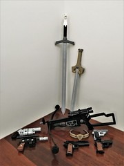 The Arsenal (Lego Admiral) Tags: sword longclaw godkiller bowcaster blaster pistol colt1911 waltherppk lego legoadmiral