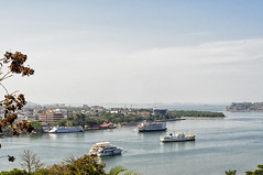 River Mandovi and the Sea and the Gambling Boats at Panjim, Goa (Anoop Negi) Tags: goa india panjim panaji river mandovi gambling boat boats cityscape waterscape landscape color anoop negi ezee123 photo photography tourism travel traveling