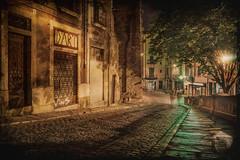 Girona (Luc Mercelis) Tags: girona sonyilce7 minoltaprimelens night nightshot nightscene textureeffects texture spain green yellow red blue streetphotography streetlights street streetlight streetlamp