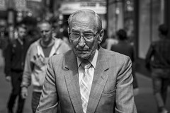 The Shirt and Tie Generation (Leanne Boulton) Tags: urban street candid portrait portraiture streetphotography candidstreetphotography candidportrait streetportrait streetlife old elderly man male face facial expression look emotion feeling mood atmosphere suit tie smart dapper style tone texture detail depthoffield bokeh naturallight outdoor light shade shadow city scene human life living humanity society culture people canon canon5d 5dmkiii 70mm character ef2470mmf28liiusm black white blackwhite bw mono blackandwhite monochrome glasgow scotland uk