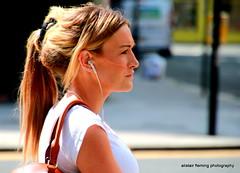 IMG_4858 Street candid (marinbiker 1961) Tags: streetcandid female woman colour glasses longhair outdoors earplugs hat sunglasses scarf portrait people sigmalens