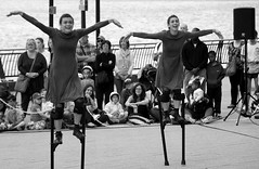 Gravity? What gravity? (_steve h_) Tags: streetphotography london urban candid sony nex6 gdif 2017 greenwich docklands international festival contemporary dance mulïer fly flying stilts ladies bw blackandwhite monochrome gravity