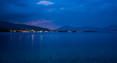 Calm Before the Storm (free3yourmind) Tags: calm before storm lightning flash strike sea water blue transparent aigio egio greece mountains bay akoli beach stones outdoor seascape clouds cloudy