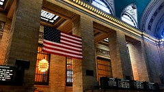 Grand Central Station III (joeclin) Tags: northamerica america unitedstates usa newyork ny manhattan nyc midtowneast color appleiphone7 iphone iphoneography grandcentralstation architecture amateur 2010s flag columns landmark perspective