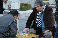 Your move! (Elios.k) Tags: horizontal outdoors people two men old elder japanese facialexpression surprise game boardgame traditional shogi japanesechess move chess strategygame playing minatopark square outside leisure activity board wedgeshapedpieces colour color dof bokeh generalsgame travel travelling december 2016 winter vacation canon 5dmkii camera photography nagasaki nagasakiprefecture kyushu japan asia