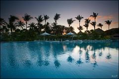 Sunset by the pool (katepedley) Tags: fiji south pacific tropics tropical melanesia viti levu korotoga sigatoka coral coast outrigger resort sunset evening dusk