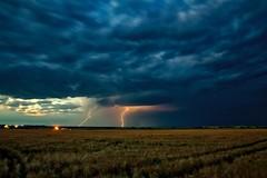Barley field Lightning (John Andersen (JPAndersen images)) Tags: airdrie alberta barley canola clouds crossfield farm fence lightning rain road smoke storm sunset
