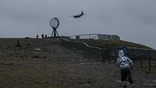 Man & machine running for Nordkapp ( North Cape ) Norway