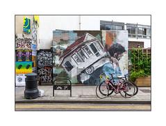 Street Art (Helen Bur), East London, England. (Joseph O'Malley64) Tags: abcdefghelens helenbur streetartist streetart urbanart publicart freeart graffiti eastlondon eastend london england uk britain british greatbritain art artist artistry artwork mural muralist wallmural wall walls servicesshed utilitiescabinet brickwork bricksmortar cement pointing windows barredwindows render billposters sign signage gate entrance exit doubledoors steeldoors padlock padlocked trelace creeper cycleparking bicycles bikes cycles accesscovers refusebin rubbishbin rubbishsack pavement planter woodenplanter granitekerbing tarmac doubleyellowlines noparkingatanytime parkingrestrictions urban urbanlandscape aerosol cans spray paint fujix x100t accuracyprecision