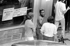 h42-68 11 (ndpa / s. lundeen, archivist) Tags: nick dewolf nickdewolf bw blackwhite photographbynickdewolf film monochrome blackandwhite city summer 1968 1960s 35mm boston massachusetts candid streetphotography citylife streetlife people beaconhill charlesstreet sidewalk pedestrian youngpeople july sunday weekend july28 pedestrians storefront business car vehicle automobile parkedcar man youngman men youngmen window storewindow restaurant sign signs special specials charlesstreetsteakhouse bike bicycle swordfish barbecuedchicken hair choppedsirloin 149 glasses sunglasses shades brunette black africanamerican longhair blond blonde sideburns charbroiled tasty