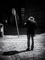 Map Reading Exercise (Feldore) Tags: gothenburg candid street man panama sweden map reading light shadows hat feldore mchugh em1 olympus 1240mm behind anonymous