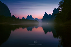 Peaceful Dawn (fesign) Tags: asia beautyinnature boat chinaeastasia cloudsky colourimage day dusk eastasia guangxizhuangautonomousregionchina guilin hill horizontal lake locallandmark morning mountain mountainrange nature naturereserve outdoors photography reflection river riverli rollinglandscape ruralscene scenics sky skyline sunlight sunrise sunrisedawn tranquilscene travel traveldestinations water xianggongshan yangshuo