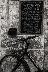 30/52: The writing's on the wall... (judi may) Tags: 100xthe2017edition 100x2017 image68100 malta valetta sign bike bicycle mono monochrome blackandwhite writing wall wheel spokes canon7d