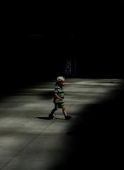 Boy (Kornelson) Tags: boy light alone shadow shadows walk walking hat dark fuji fujifilm krakow poland xt1 xf60