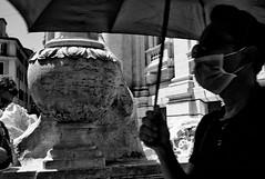 Protected!! (Baz 120) Tags: candid candidstreet candidportrait city candidface candidphotography contrast street streetphoto streetcandid streetphotography streetphotograph streetportrait rome roma romepeople romestreets romecandid europe monochrome monotone mono blackandwhite bw noiretblanc urban voigtlandercolorskopar21mmf40 voightlander leicam8 leica life italy italia girl grittystreetphotography faces decisivemoment strangers