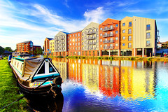 See That Glow (Idreamofpies) Tags: sun shine evening glow light apartments windows building canal new old architecture engineering water waterway shropshire union chester cheshire basin cut grass boats narrow noored fishing ripples colour sky cloud summer blue reflection towpath