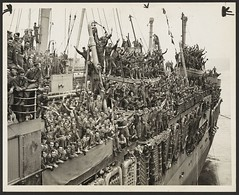 Troops of the 20th Armored Division and units of the 9th Army whoop it up between raindrops as the SS John Ericsson nears Pier 84, North River. 1945 August 6 (LOC) (The Library of Congress) Tags: libraryofcongress ship troopship troopcarrier oceanliner mskungsholm1928 mskungsholm kungsholm swedishamericanline svenskaamerikalinien sal blohmvoss blohmandvoss bv warshippingadministration wsa ssjohnericsson unitedstateslines trooptransport uslines msitalia homelines msimperialbahama imperialbahama freeportbahamaenterprises soldiers 9tharmy nintharmy